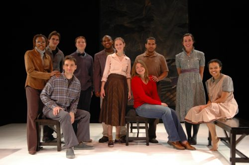 Full cast photo on the stage in costume.